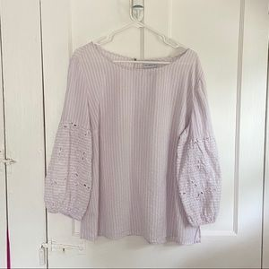 Lilac blouse with embroidered sleeves